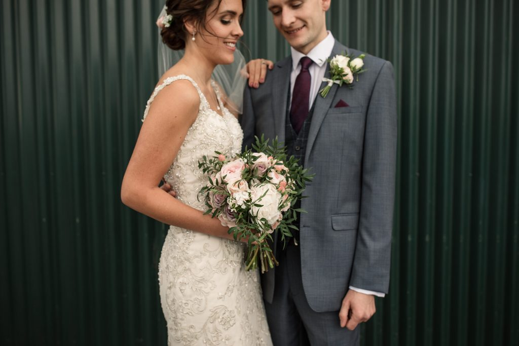 Bride and groom outside Hangar 3 at Shuttleworth Collection Wedding, taken by Becky Harley Photography