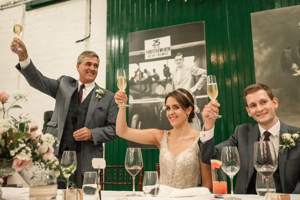 Bride and groom during wedding toast at Shuttleworth Collection Wedding, taken by Becky Harley Photography