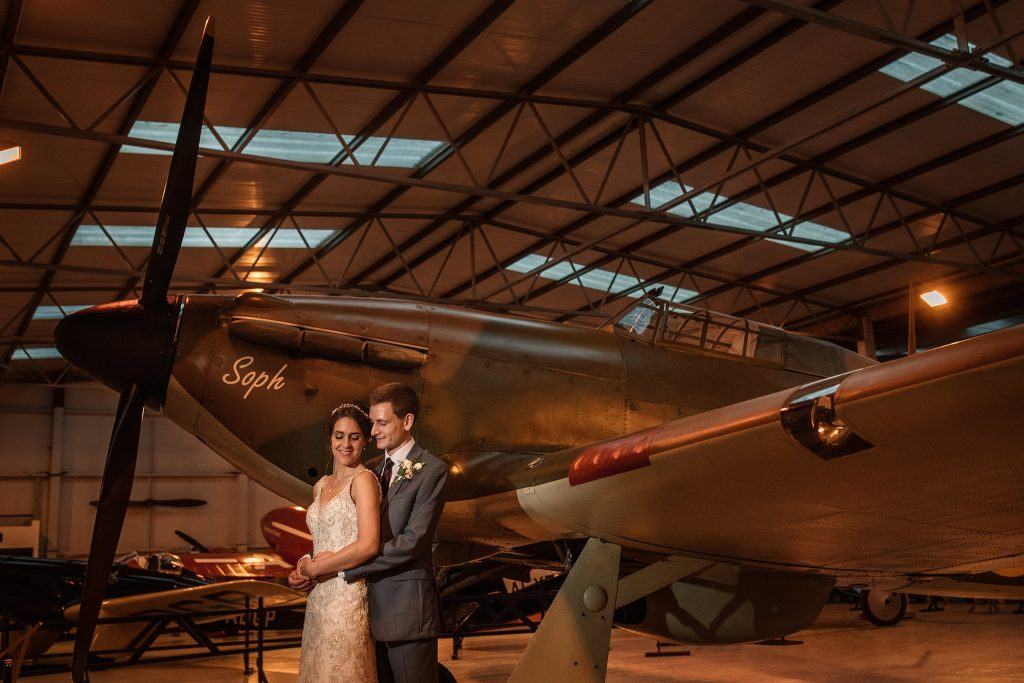 Bride and groom with vintage plane at Shuttleworth Collection Wedding, taken by Becky Harley Photography