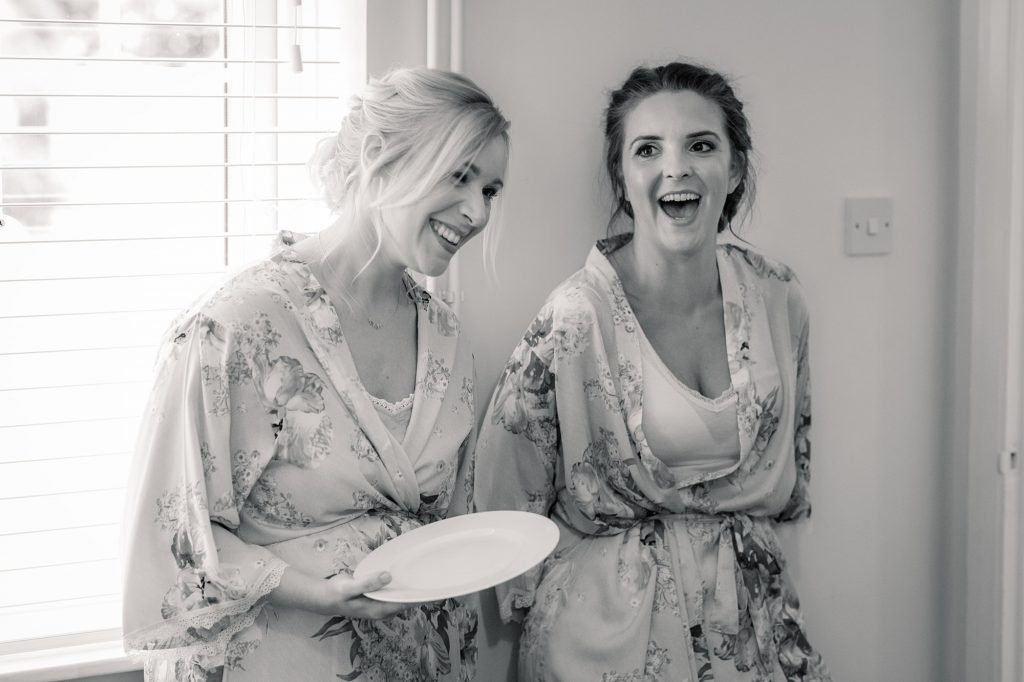 Bridesmaids laughing during wedding preparations at Granary Estates Wedding taken by Becky Harley Photography