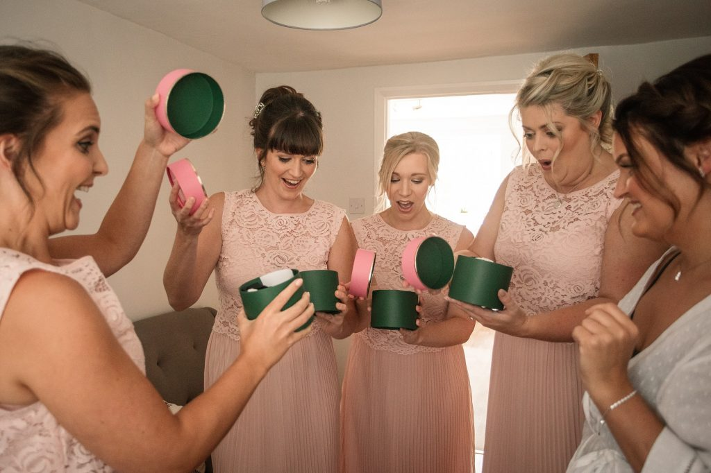 Bridesmaids opening gifts during morning preparations at Granary Estates Wedding taken by Becky Harley Photography