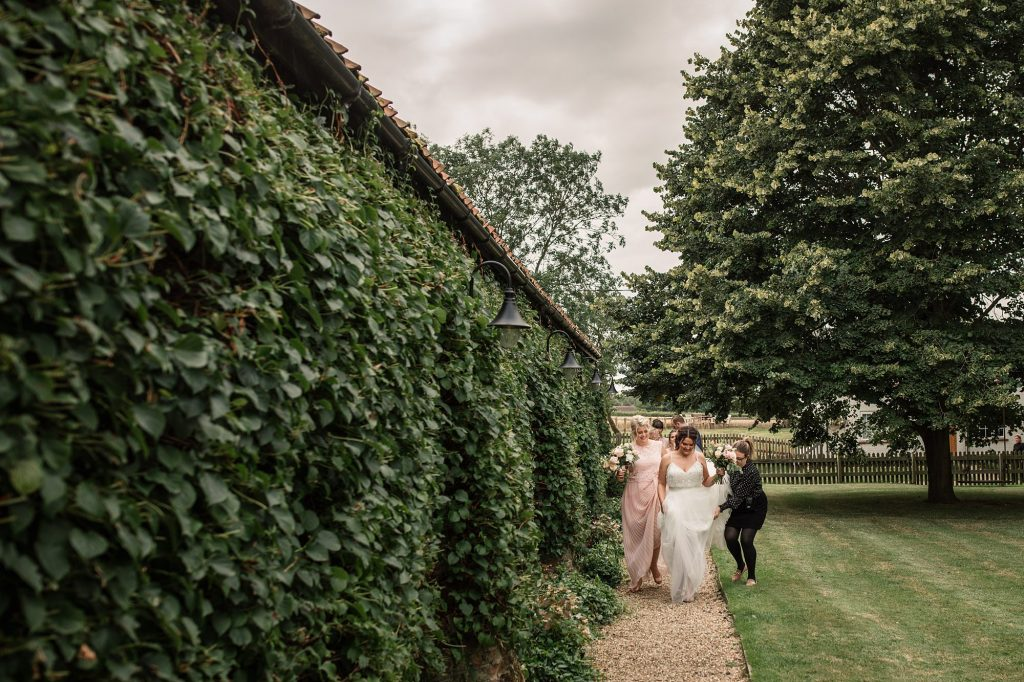 Bride walking to ceremony at Granary Estates Wedding taken by Becky Harley Photography