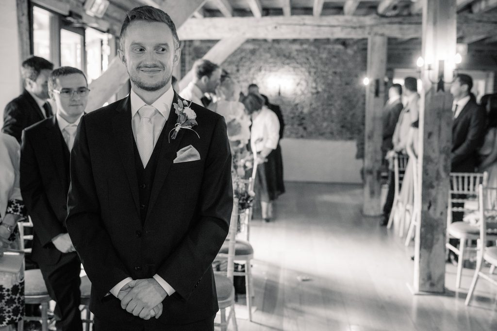 Groom waiting for bride to arrive at Granary Estates Wedding taken by Becky Harley Photography
