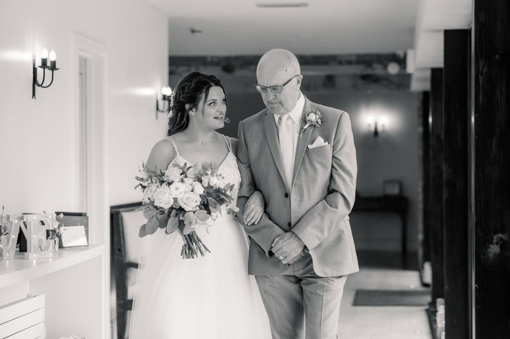 Bride and her dad walking to ceremony at Granary Estates Wedding taken by Becky Harley Photography