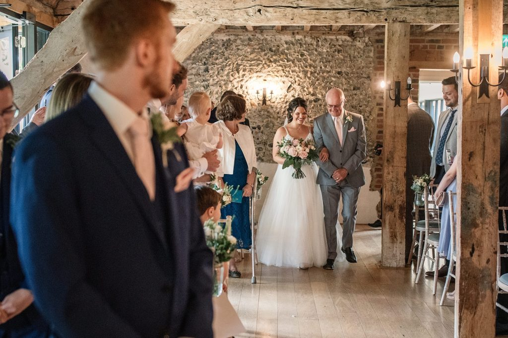 Bride and father walking down the aisle at Granary Estates Wedding taken by Becky Harley Photography