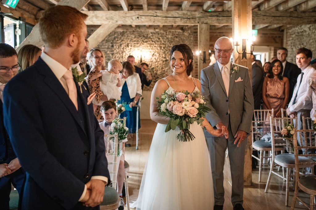 Bride meeting groom at the end of the aisle at Granary Estates Wedding taken by Becky Harley Photography