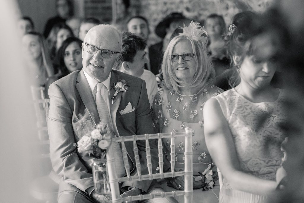 Father and Mother of the bride watching wedding ceremony at Granary Estates Wedding taken by Becky Harley Photography