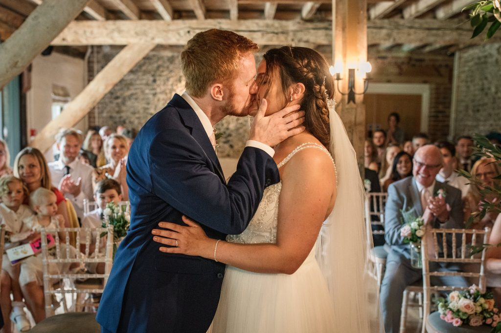 Bride and Groom first kiss at Granary Estates Wedding taken by Becky Harley Photography