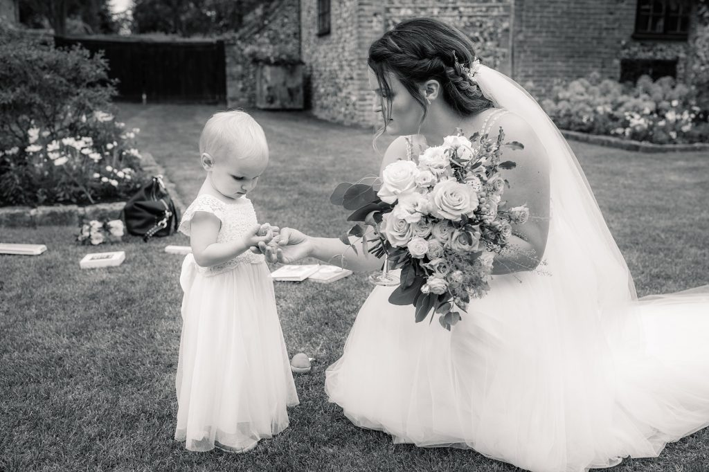 Bride with flower girl at Granary Estates Wedding taken by Becky Harley Photography