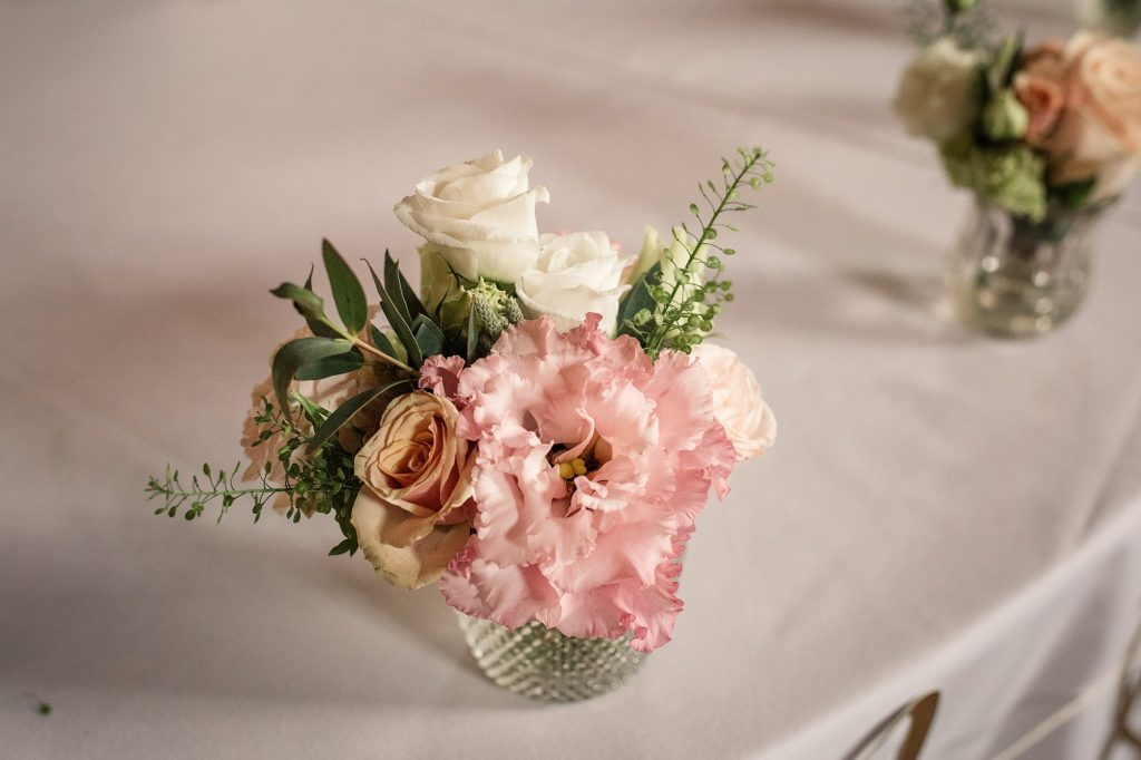 Table flowers by Feather and Ferns at Granary Estates Wedding taken by Becky Harley Photography