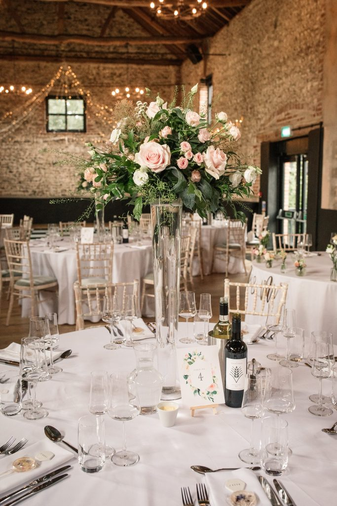 Table centres by Feather and Ferns at Granary Estates Wedding taken by Becky Harley Photography