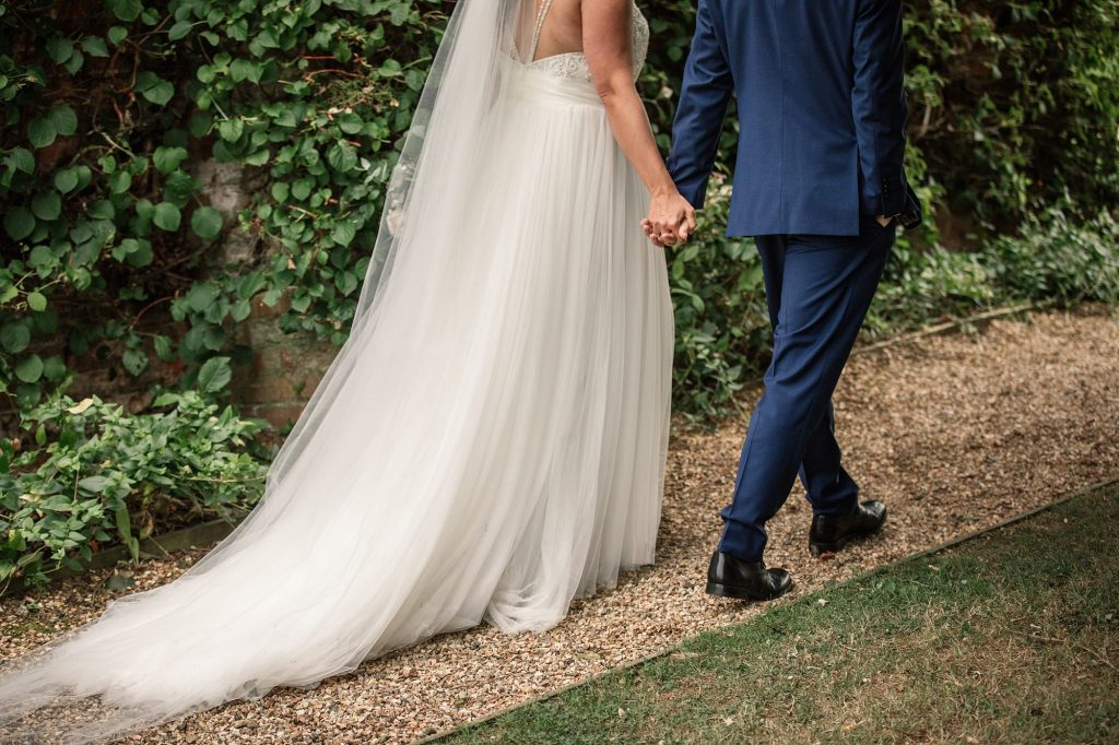 Bride and groom walking at Granary Estates Wedding taken by Becky Harley Photography