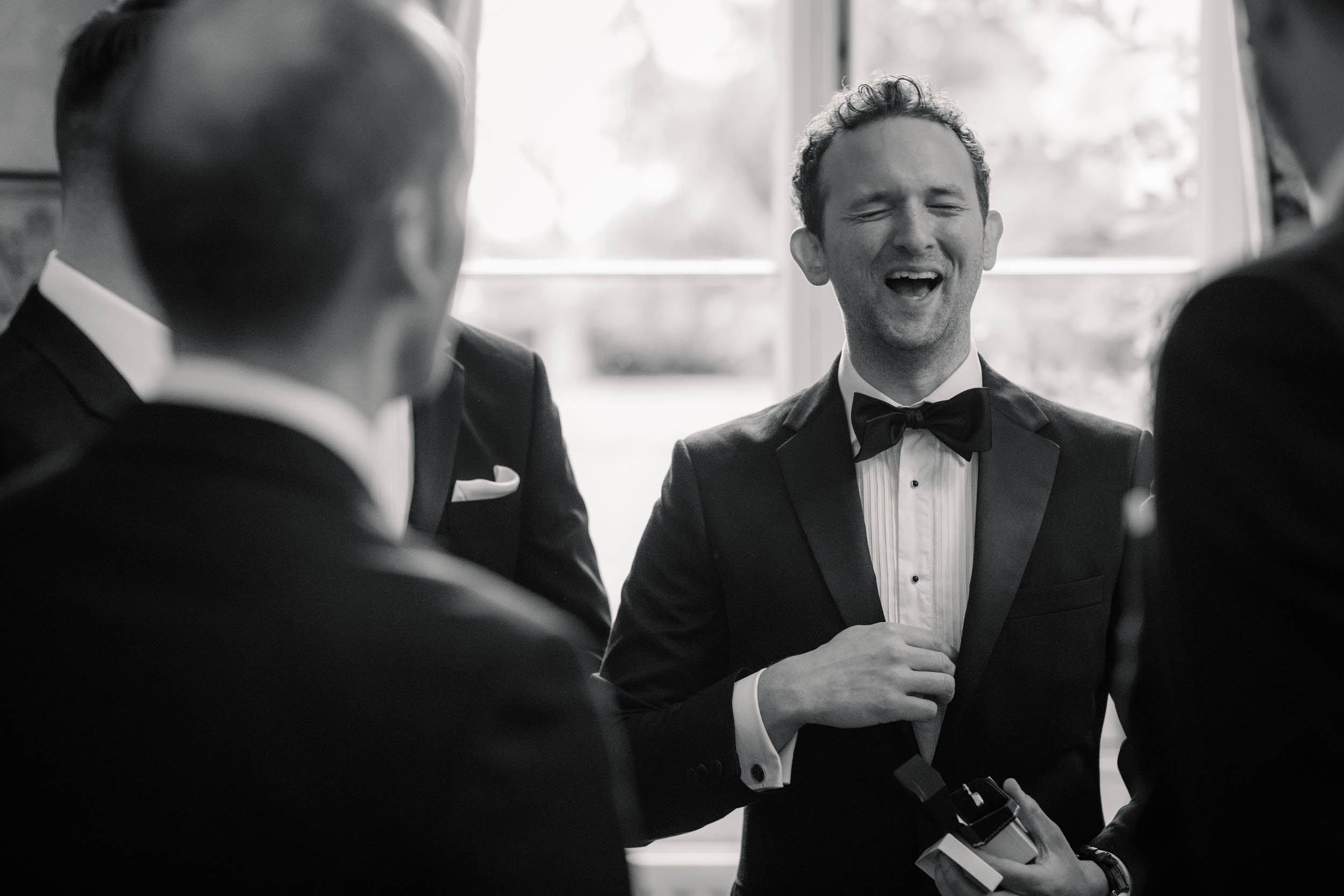 Groom laughing with ushers At autumnal Offley Place wedding taken by Becky Harley photography