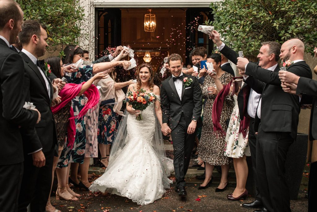 Bride and Groom with confetti at autumnal Offley Place wedding taken by Becky Harley photography