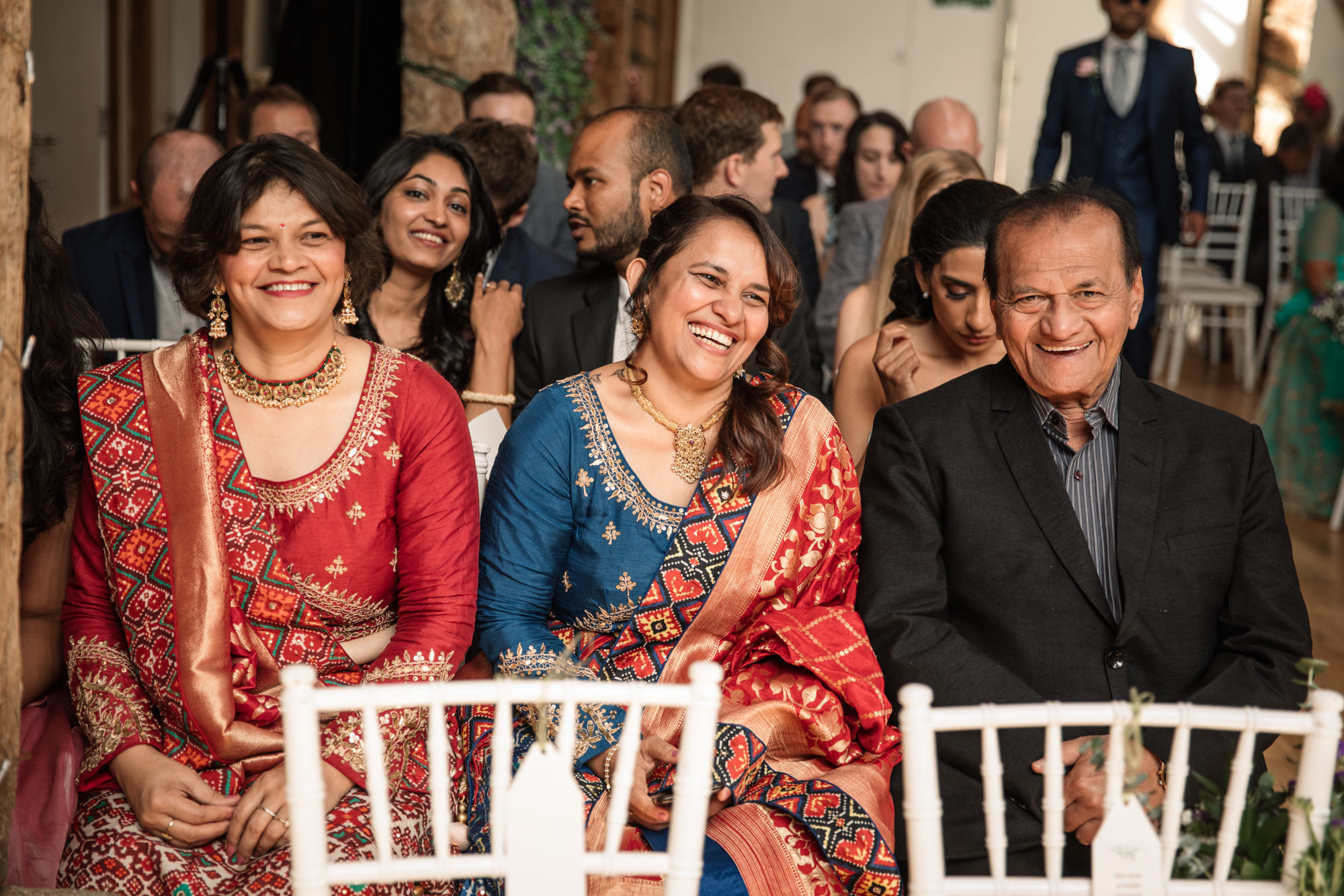 Guests in colourful Indian saris during wedding ceremony