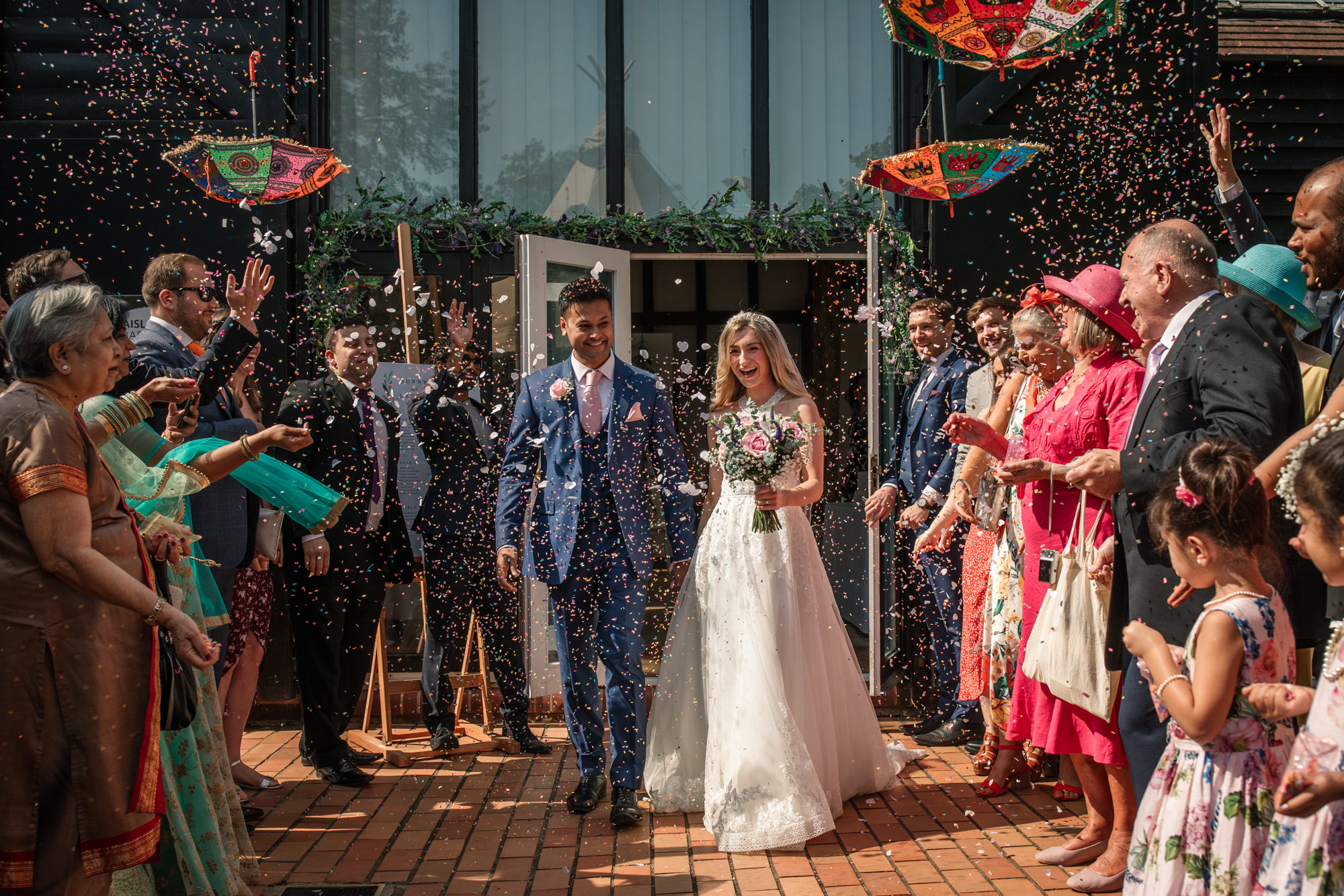 Bride and Groom with confetti at Henry Moore Studio wedding